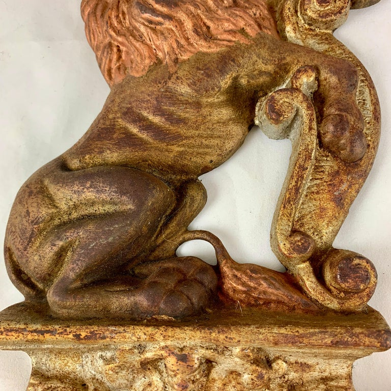 Vintage 1930s French Gilded Cast Iron Heraldic Lion Doorstops or Bookends a Pair In Good Condition For Sale In Philadelphia, PA