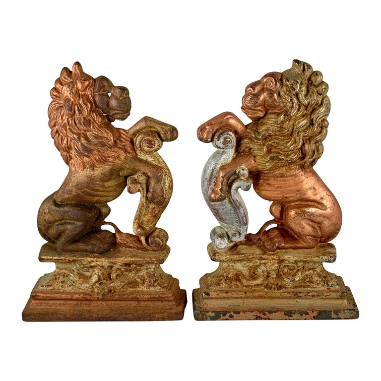 Vintage 1930s French Gilded Cast Iron Heraldic Lion Doorstops or Bookends a Pair For Sale