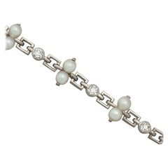 Vintage 1940s 0.82 Carat Diamond and Natural Pearl Platinum Bracelet