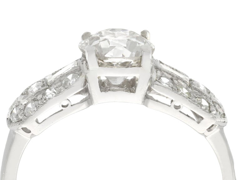 A fine and impressive vintage 1.20 carat diamond and platinum cocktail ring; part of our diverse vintage jewelry and estate jewelry collections.  This fine and impressive 1.20 carat diamond ring has been crafted in platinum.  The pierced decorated