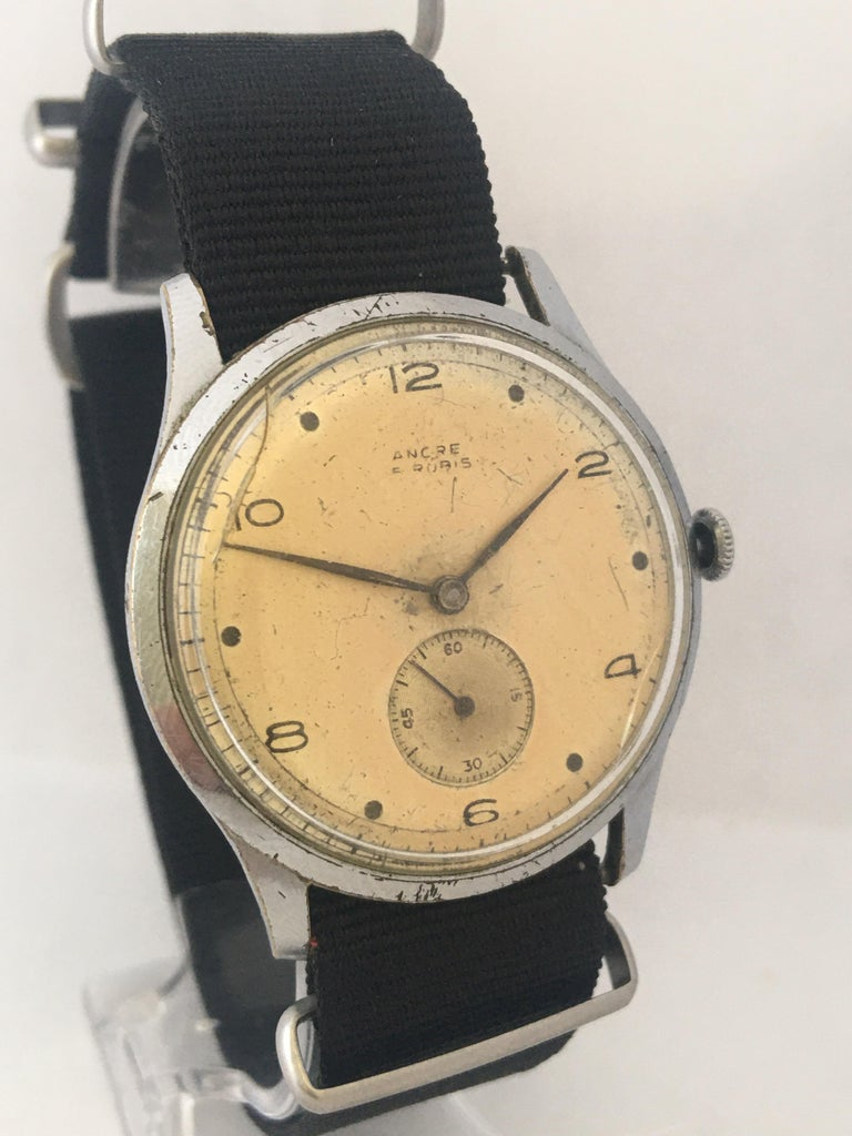 This pre-own vintage hand-winding Watch working and it is running well( keeps a good time) . There are visible signs of ageing and wear with cracks on the glass as shown. Light scratches and tarnishes on the watch case. the dial has aged. Fitted