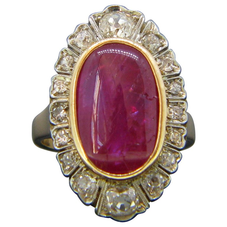 Vintage 1940s Burmese 10 Carat Ruby Cabochon and Diamonds Cluster Ring For Sale