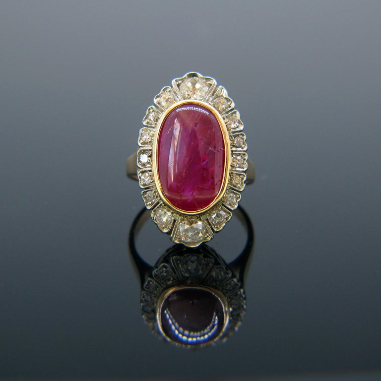 This vintage ring is set with a 10ct Burmese Ruby Cabochon and is surrounded with 16 diamonds – old cut and single cut. The diamonds are set in platinum and the rest of the ring is in 18kt rose gold. It was made circa 1940s. The cabochon shows
