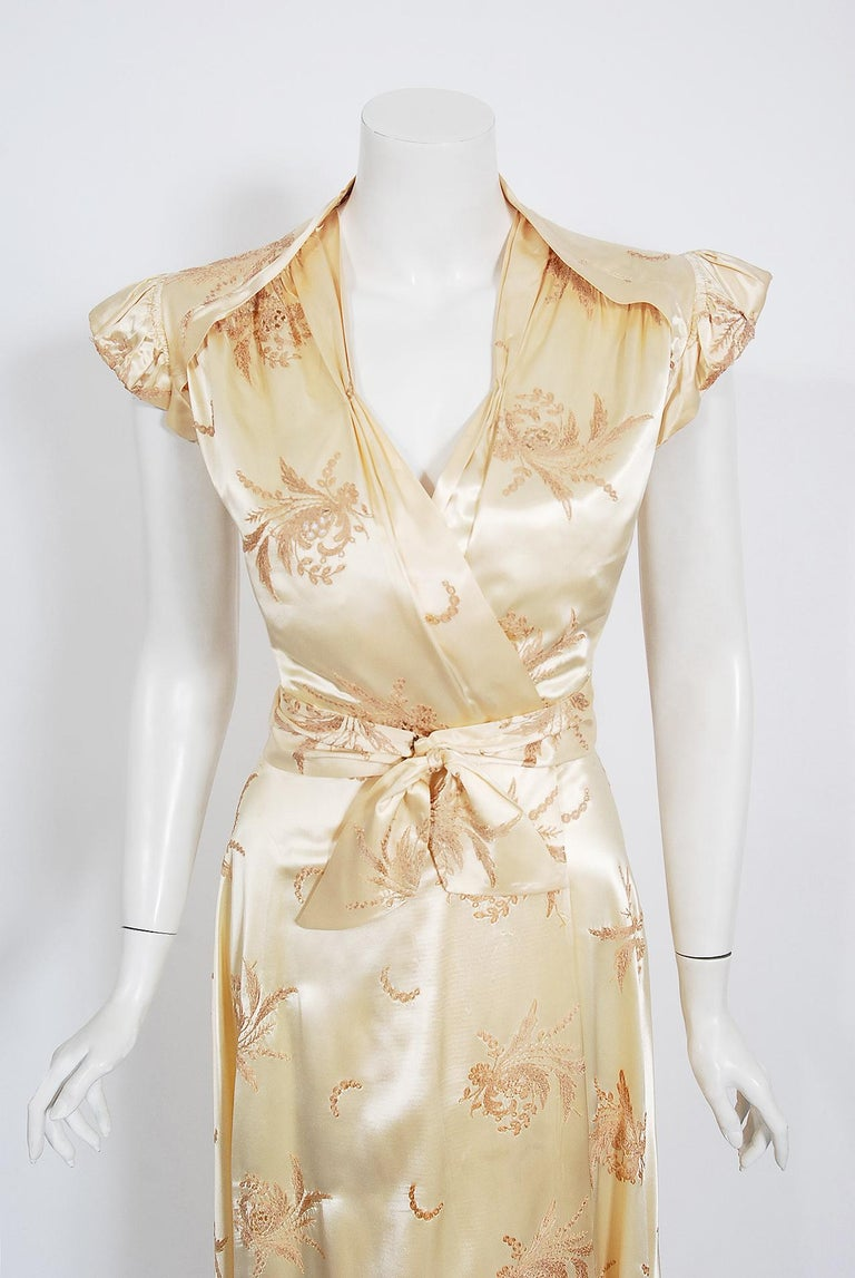 The breathtaking embroidered creme silk-satin used for this 1940's dressing gown has a fresh innocence that I find irresistible. The bodice has a flirty low-cut plunge and the most beautiful winged cap-sleeves. Love the cut-out details which show