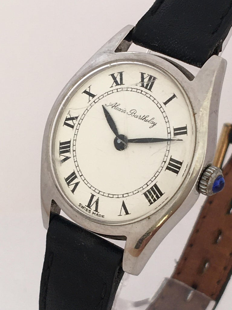 This beautiful vintage pre-own mechanical watch is working and ticking well.