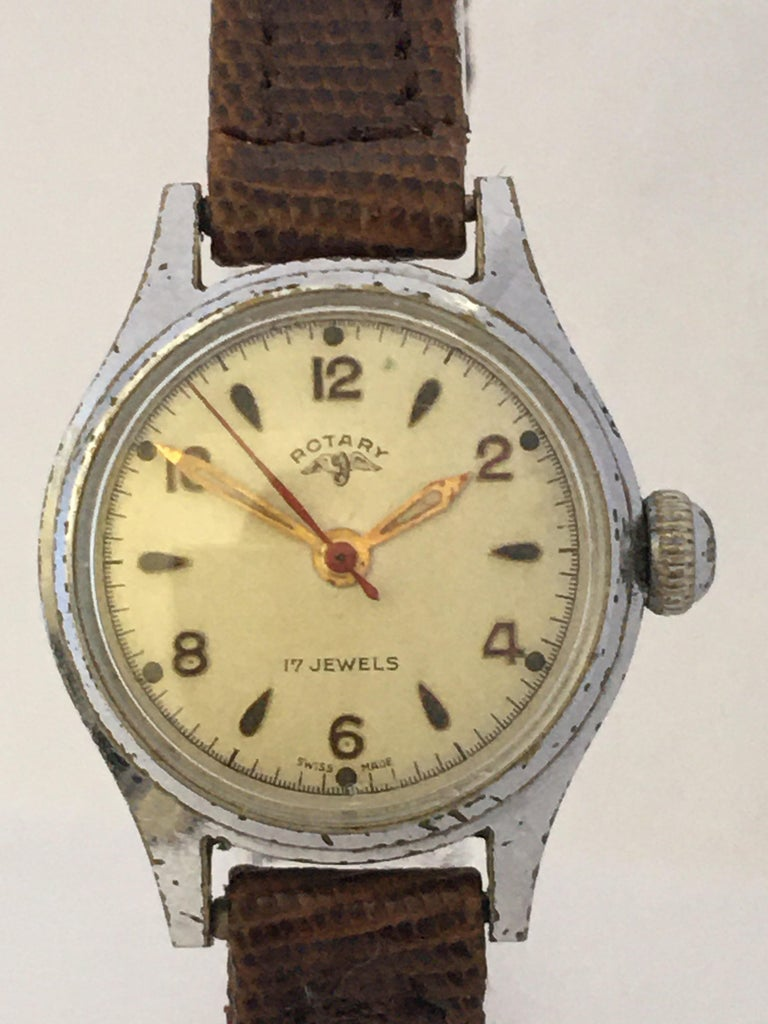 This beautiful pre-owned hand winding ladies watch is in good working condition and it is running well. Visible signs of ageing and wear with light scratches and tarnishes on the silver plated watch case as shown.   Please study the images carefully