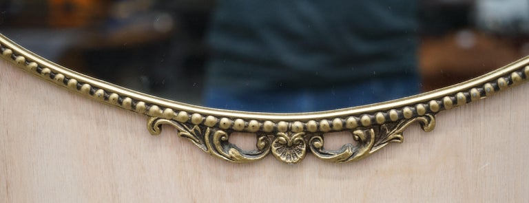 Beveled Vintage 1940's Solid Metal Framed Mirror with Ornate Casting of Ribbons & Beads For Sale