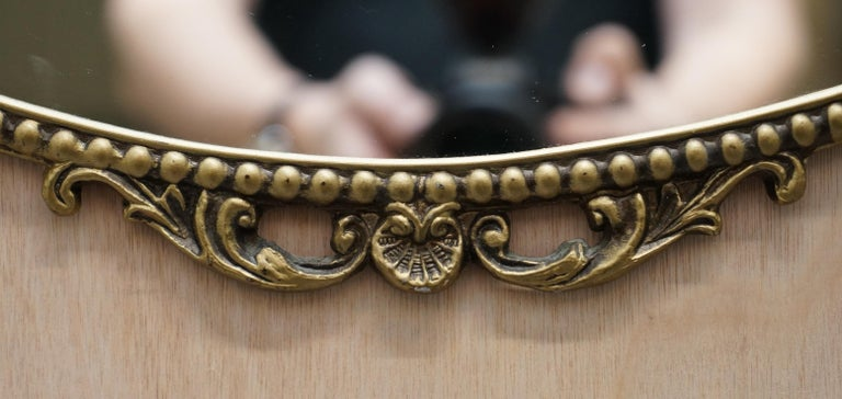 Vintage 1940's Solid Metal Framed Mirror with Ornate Casting of Ribbons & Beads In Good Condition For Sale In London, GB