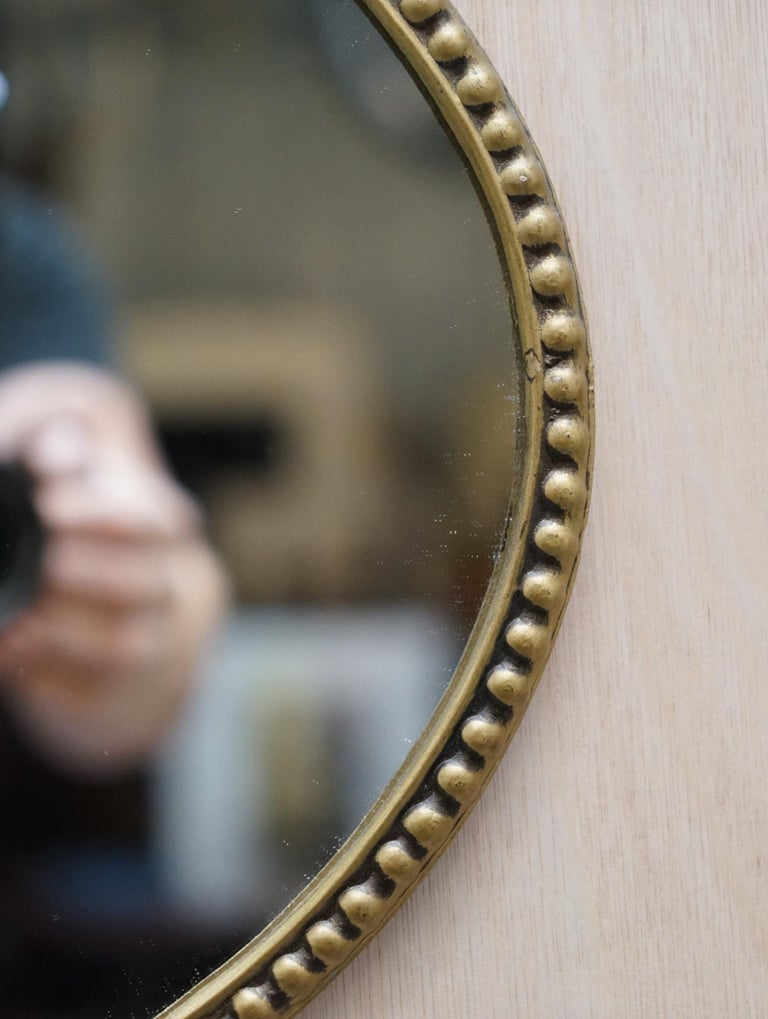 Mid-20th Century Vintage 1940's Solid Metal Framed Mirror with Ornate Casting of Ribbons & Beads For Sale