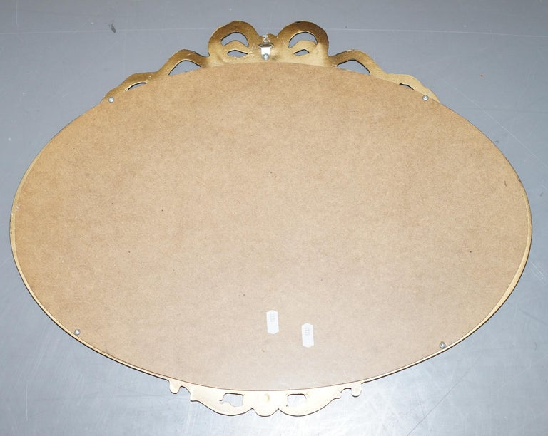 Vintage 1940's Solid Metal Framed Mirror with Ornate Casting of Ribbons & Beads For Sale 1