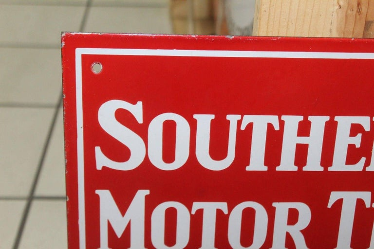 Porcelain sign was normally hung outside of the bus station advertising Southern Pacific Lines.