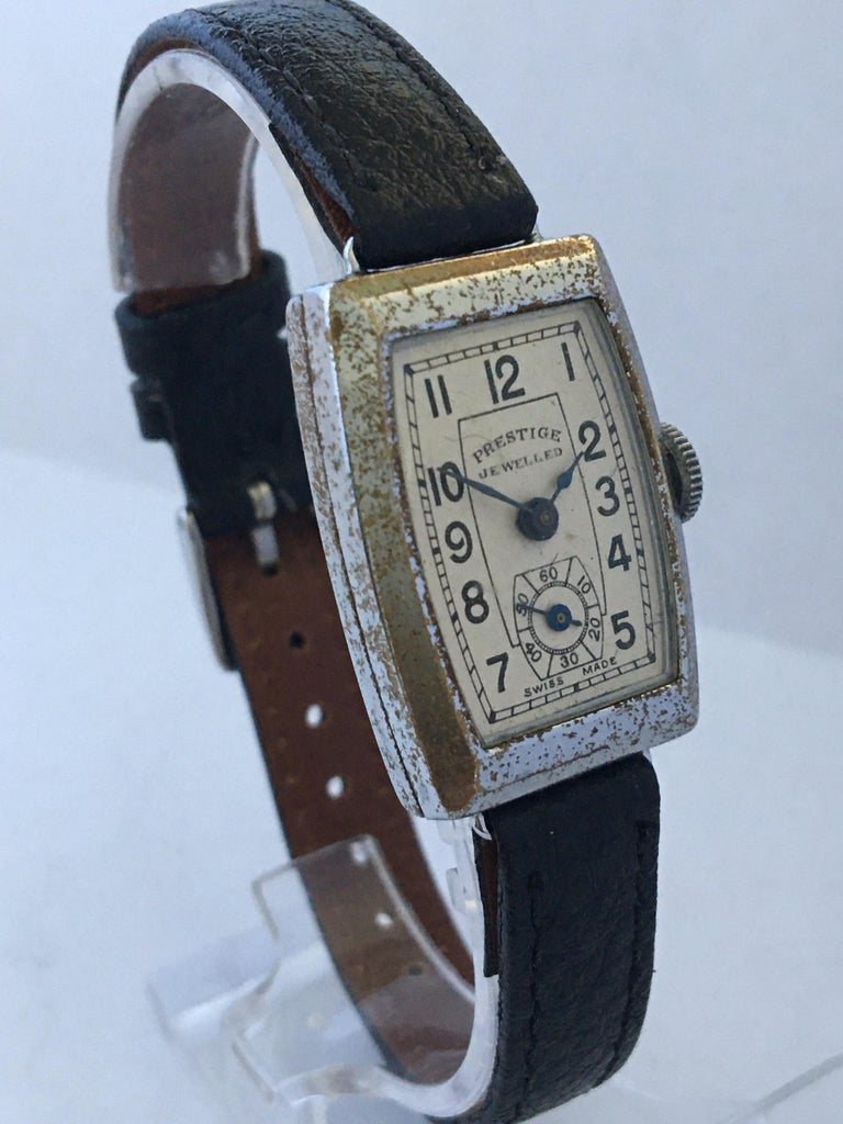 This beautiful vintage mechanical watch is working and is ticking well. Visible signs of ageing and wear. The silver plated watch case is tarnished as shown.   Please study the images carefully as form part of the description.