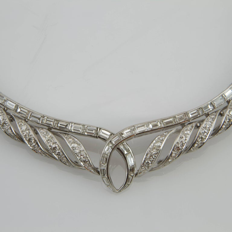 18kt white gold and platinum waterfall patterned necklace. Each volute turned into a spiral set with brilliant cut diamond. The core pattern is stud with baguette diamond.  Total weight of diamonds estimated around 18 to 20 carats.  Great design