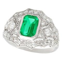 Vintage 1950s 1.49 Carat Emerald and 1.15 Carat Diamond Platinum Cocktail Ring