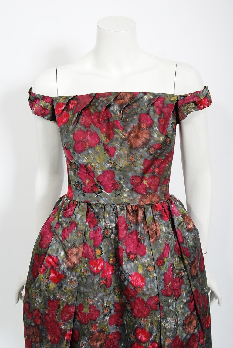 In this gorgeous 1950's Claire Schaffel designer cocktail dress, the detailed construction and meticulous attention to detail are comparable to what you will find in modern couture. Claire Schaffel was a native of Switzerland where she had her own