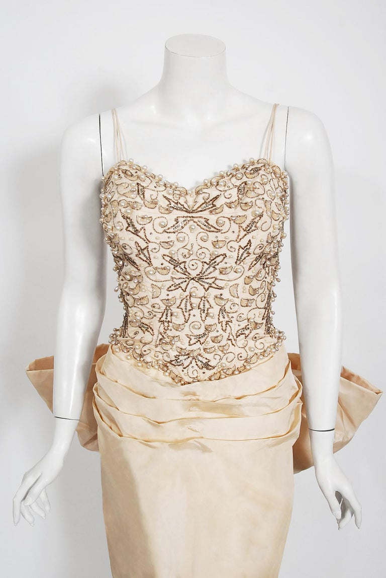 Beige Vintage 1950's Custom Couture Beaded Jeweled Ivory Silk Hourglass Back-Bow Gown For Sale