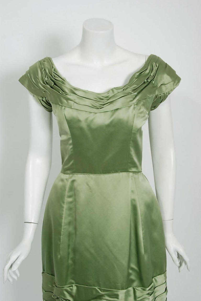 Such an elegant and timeless 1950's cocktail dress from the Evelyn Brown Washington D.C designer label. Perfect for any upcoming party; you can't help but feel feminine in this beauty! The garment is fashioned from a stunning mid-weight lined sage