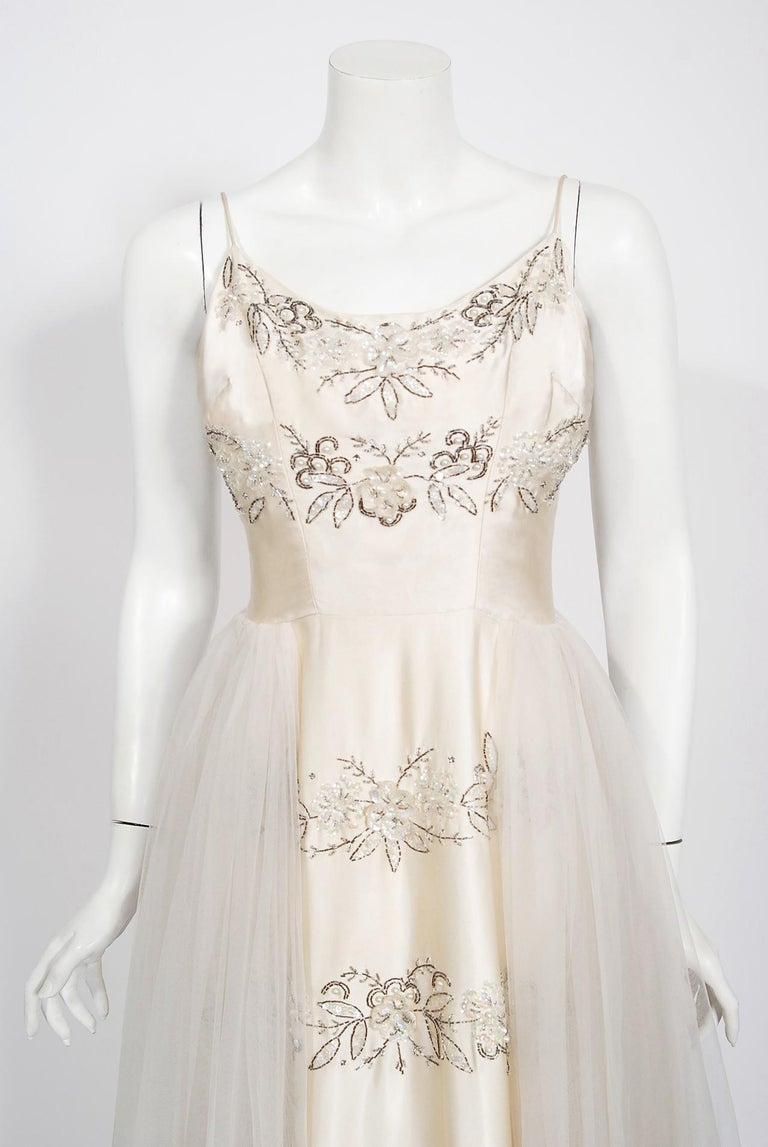 Breathtaking mid-1950's ivory white bridal dress by the highly adored label