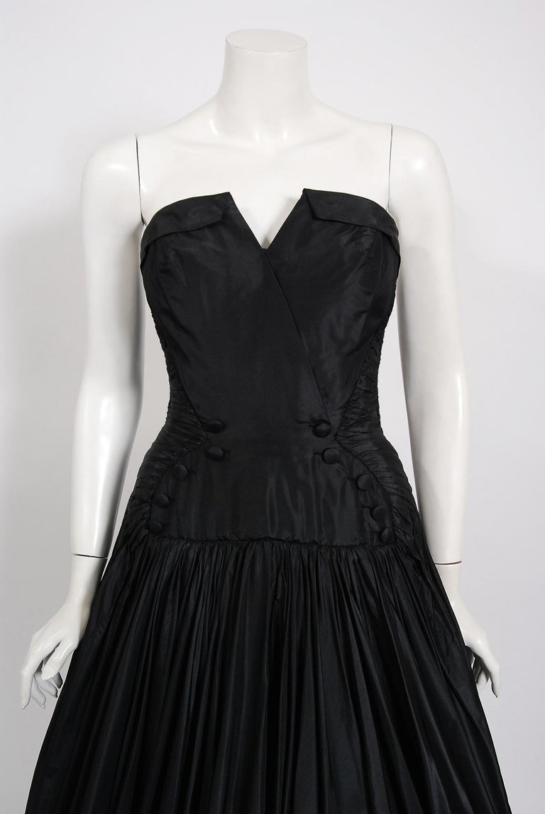 In this gorgeous French mid-century 'New Look' dress, the detailed construction and meticulous attention to detail are comparable to what you will find in modern day haute couture. From the skillful interior boning bustier to the complex techniques,