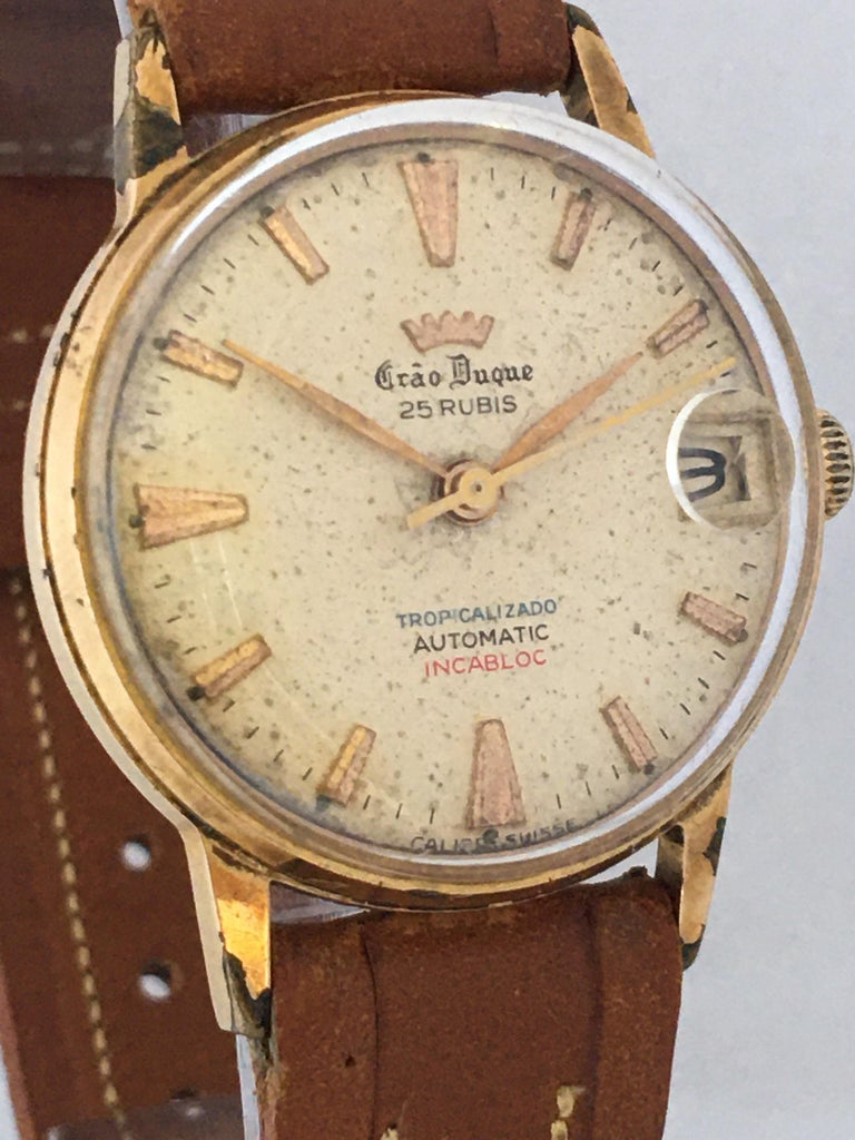 This beautiful pre-owned mid-size automatic Swiss watch is in good working condition and is running well. visible signs of ageing and wear with the dial is a bit worn, the gold plated case is a bit tarnished and some tiny scratches on the stainless