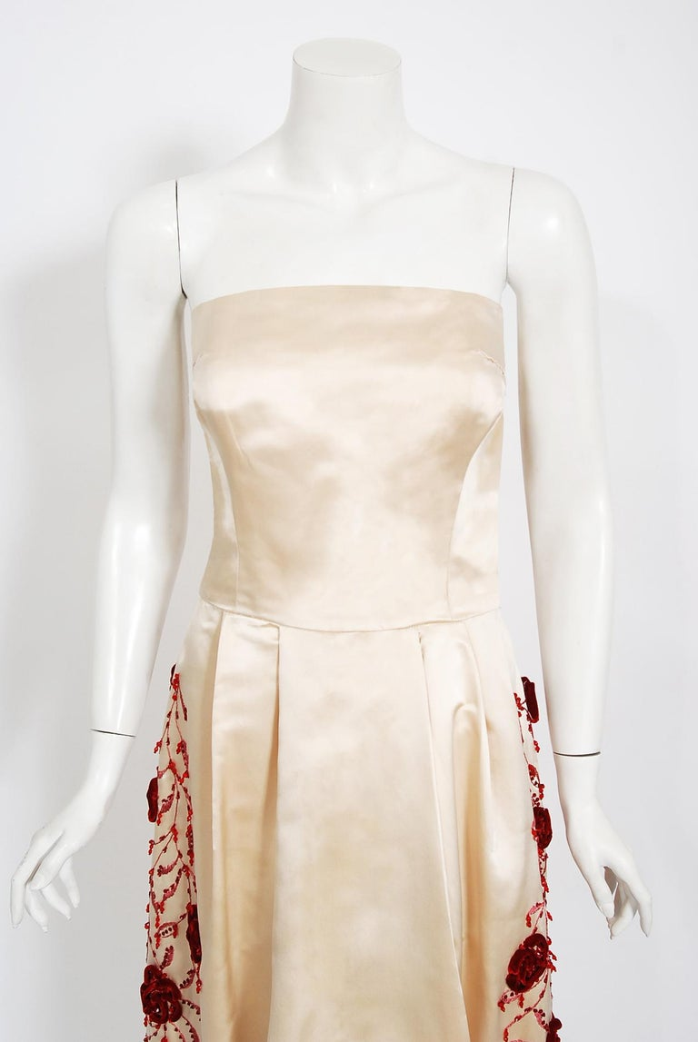 Gorgeous Harvey Berin designer silk-satin formal dress dating back to the early 1950's. Harvey Berin opened his business in 1921, and by the 1940's he was an important name in women's fashion. His designer, Karen Stark, adapted the latest styles