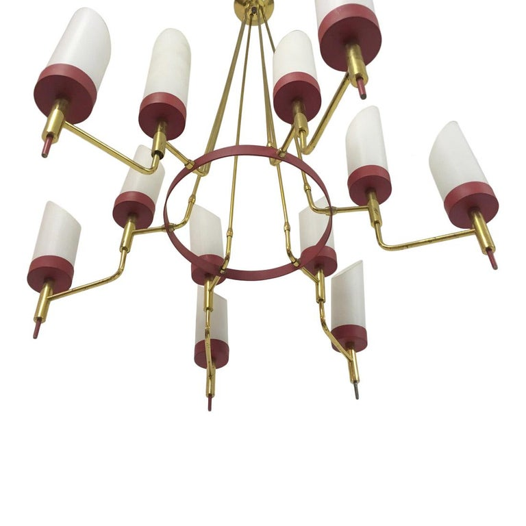 Brass framed chandelier Painted red metal With white glass diffusers Italian 1950s.