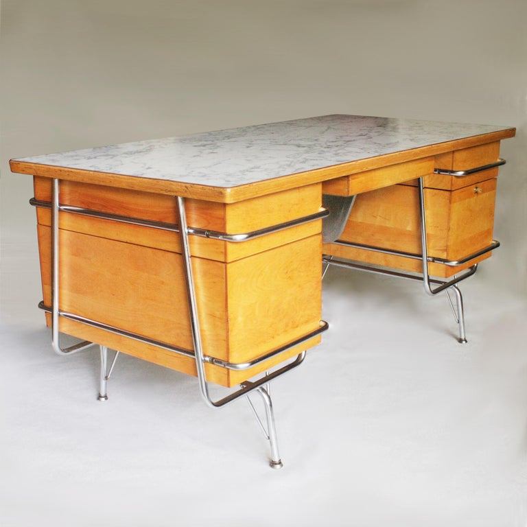 This is a wonderful example of KEM Weber's classic Trimline desk design for Heywood Wakefield. This desk is fresh off a full restoration and has been tastefully updated with new faux marble formica top and hammered-gray enamel modesty panel. These