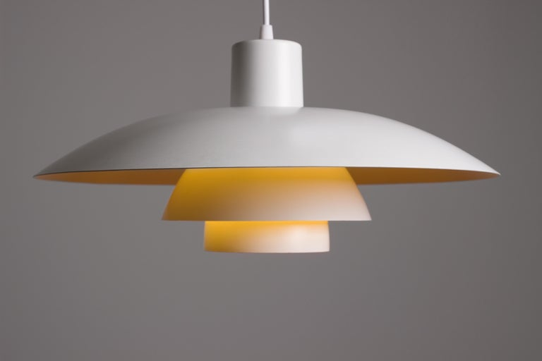 Poul Henningsen PH 4/3 pendant for Louis Poulsen. Vintage 1950s example with slightly yellowed paintwork and mild patina. Rewired. Beautiful and functional Scandinavian Modern design. Parabolic lenses ensures that only soft indirect light is spread