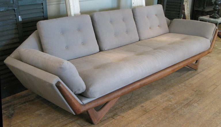 A Classic and beautiful 1950s three-seat gondola sofa designed by Adrian Pearsall for Craft Associates with walnut base. one of his most iconic and recognizable designs, with angled front legs and a wide walnut band along the front of the frame.