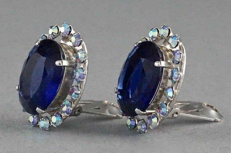Vintage 1958 CHRISTIAN DIOR Sapphire Rhinestone Earrings  Measurements: Height: 1.02 inches (2.6 cm) Width: 0.78 inch (2 cm) Weight per Earring: 6 grams  Features: - 100% Authentic 1958 CHRISTIAN DIOR. - Faceted faux sapphire stone at the centre. -
