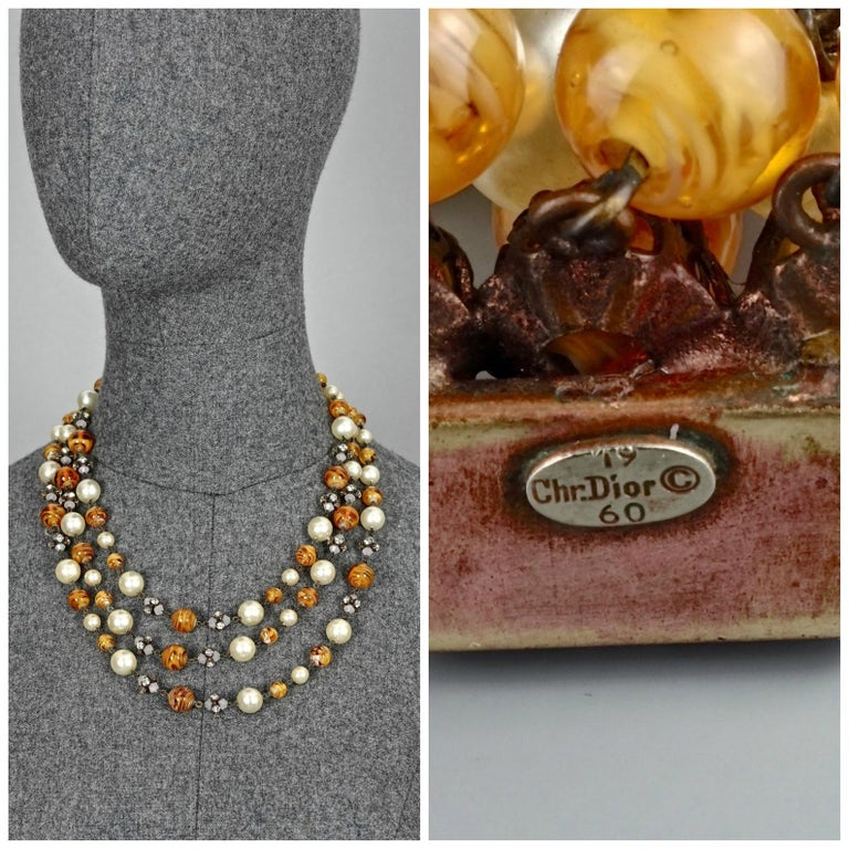 Vintage 1960 CHRISTIAN DIOR Triple Strand Amber Glass and Pearl Necklace  Measurements: Height: 1.97 inches (5 cm) Wearable Length: 25 inches (49.5 cm)  Features: - 100% authentic CHRISTIAN DIOR. - 3 tiered/ strand of glass pearls , glass beads and