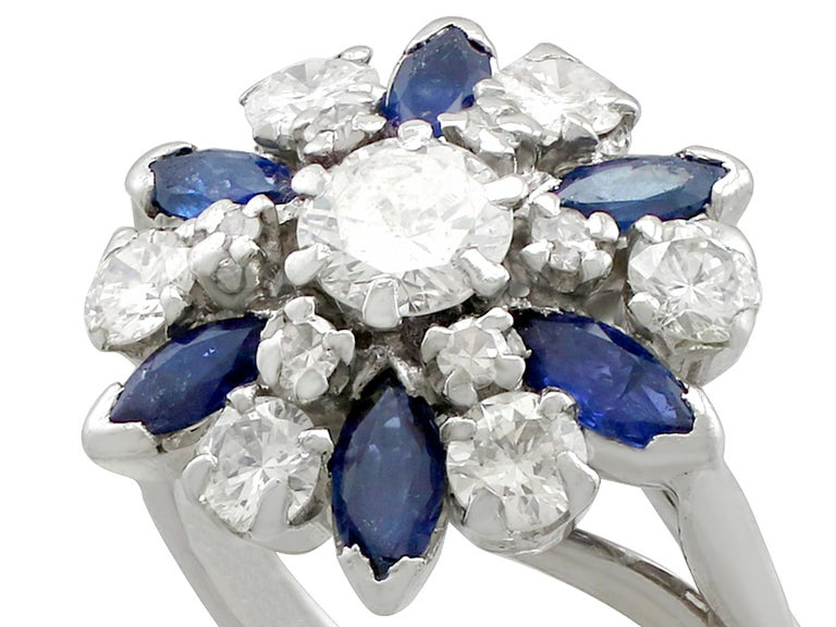 A stunning, fine and impressive vintage 1.10 carat natural blue sapphire and 1.20 carat diamond, 18 karat white gold, platinum set cluster ring; part of our vintage jewelry and estate jewelry collections.  This stunning, fine and impressive vintage