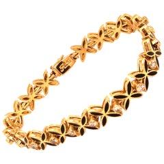 Vintage 1960s 14 Karat Yellow Gold Diamond and Black Enamel Bracelet