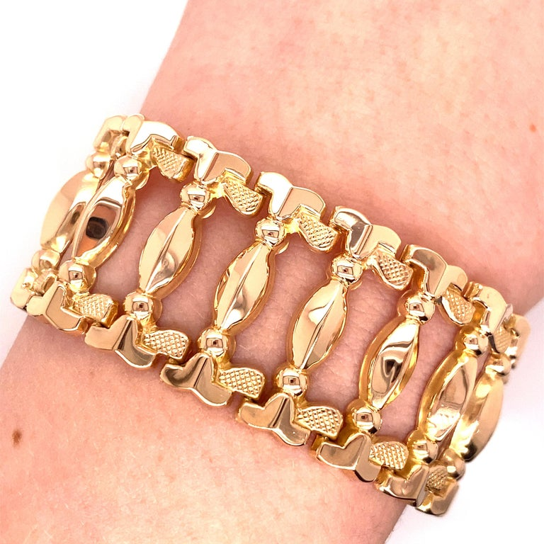 Vintage 1960's 18K Rose Gold Retro Wide Link Bracelet - The bracelet measures 1 inch wide and 8 inches long with a hidden plunger clasp and figure 8 safety. The bracelet weighs 32.77 grams.