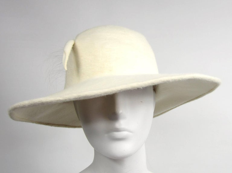 8f52c57c946633 Vintage 1960s Archie Eason Cream Feathered Oversized Fedora Hat For Sale.  Cream colored Wide Brim hat by Archie Eason. 4 inch Brim at the widest point