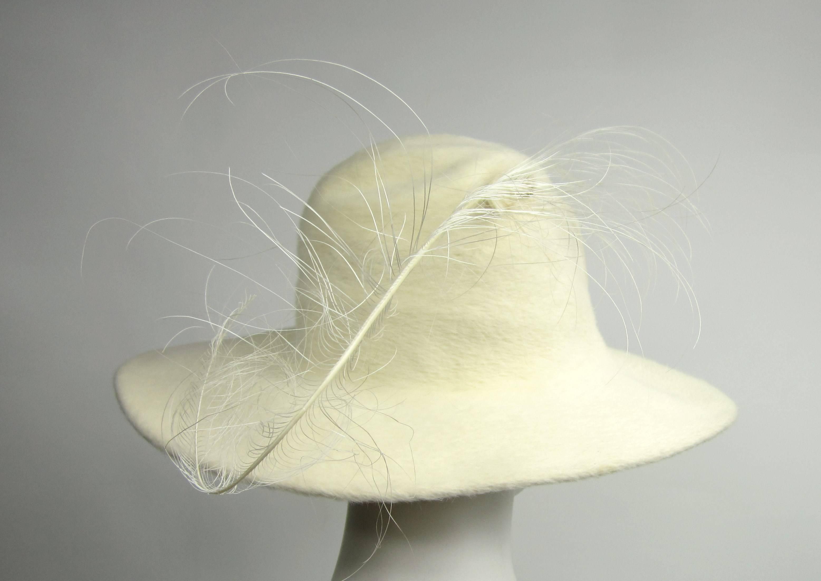 ddf28330f462e6 Vintage 1960s Archie Eason Cream Feathered Oversized Fedora Hat For Sale at  1stdibs