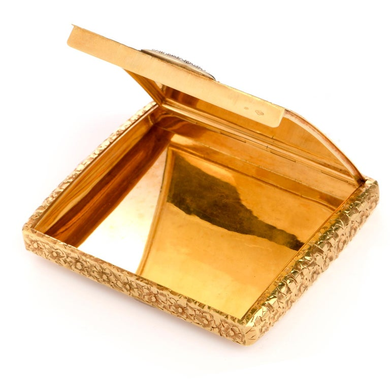 This vintage 1960's floral diamond compact box is crafted in solid 18-karat yellow gold it can be used to store your bussines cards or you pills, weighing 100.5 grams and measuring 3.50