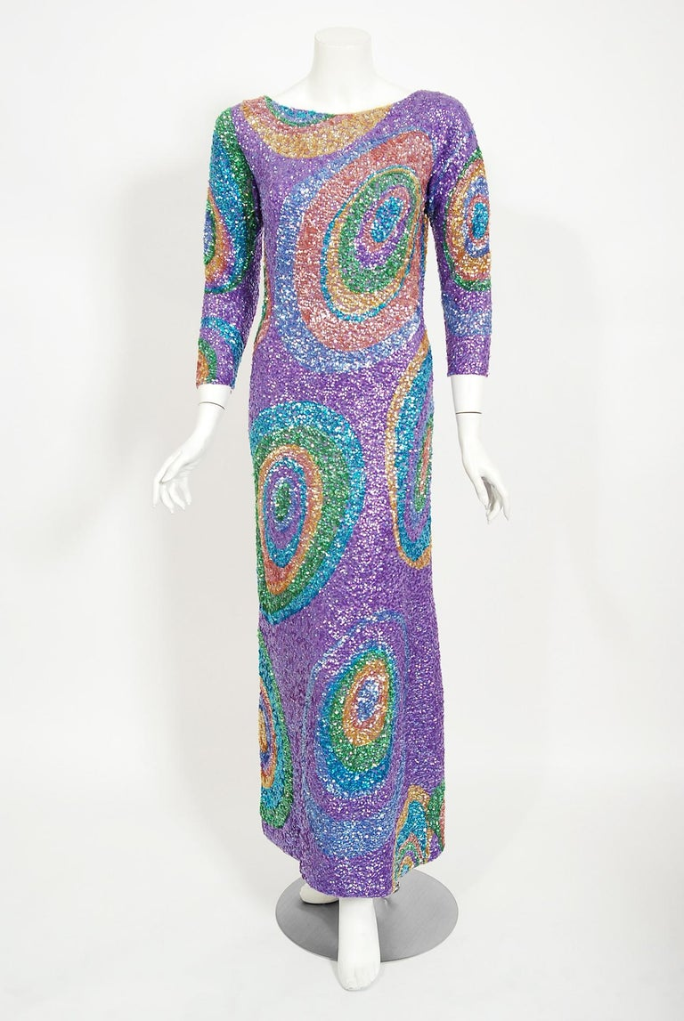 Mid-century Gene Shelly designer garments are in a class of their own. They are always fully-sequined by hand and fit to flatter the figure. This early 1960's treasure has a fantastic graphic atomic swirl design in the most beautiful colors. The