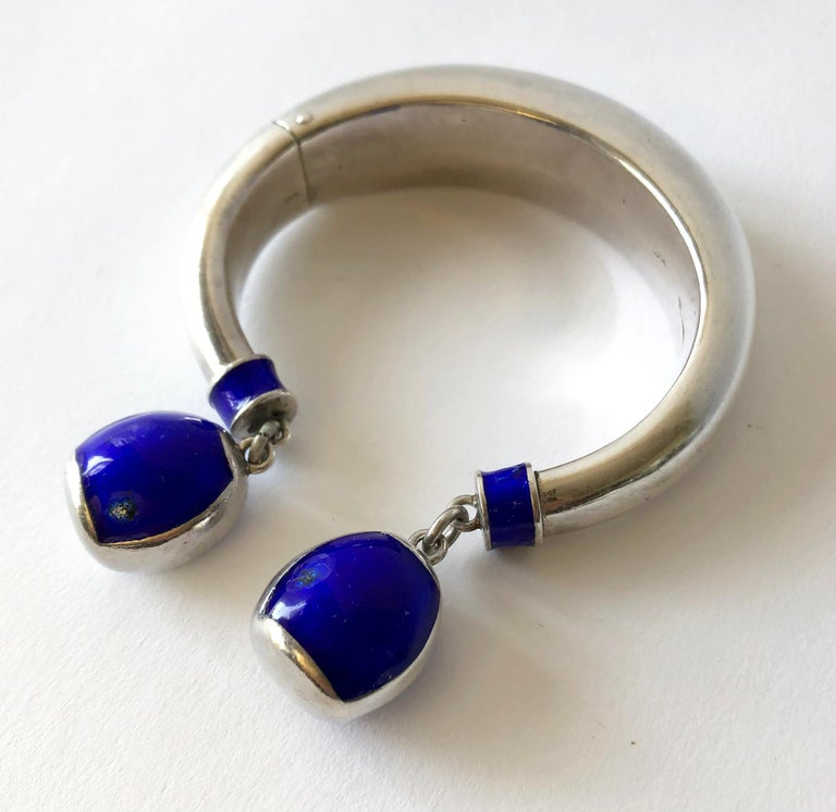 Vintage sterling silver and enamel hinged bracelet created by Gucci, circa 1960's.  Bracelet has a 7 1/4