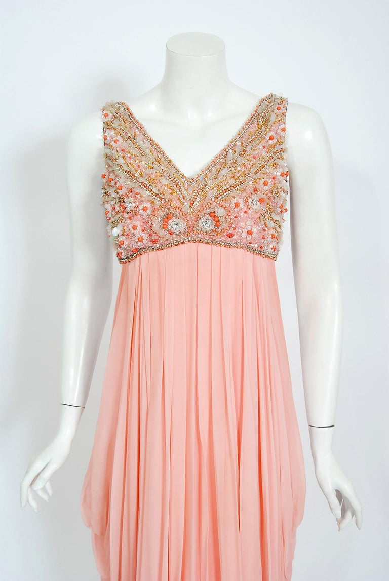 Breathtaking Helen Rose designer couture champagne-pink silk chiffon gown dating back to the mid 1960's. Helen Rose, like Edith Head and Irene Lentz, was one of the rare women who became chief costume designer for a major film studio. Her style was