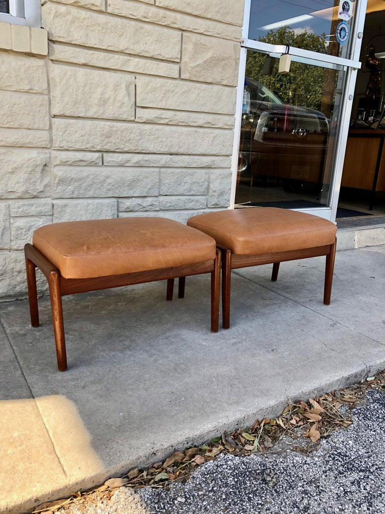 These ottomans are in overall good condition. Reupholstered in tan leather. Teak frame adjusts for reclining. See photos