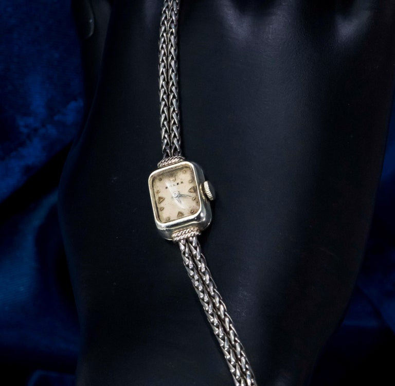 Vintage 1960s Rolex 18 Karat Gold Double Rope and Knot Motif Bracelet Watch In Fair Condition For Sale In New york, NY