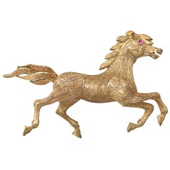 Vintage 1960s Ruby and Yellow Gold 'Horse' Brooch