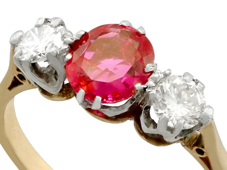 A fine and impressive vintage 0.83 carat natural ruby and 0.30 carat diamond, 18k yellow gold, platinum set, three stone/trilogy ring; an addition to our vintage jewelry and estate jewelry collections  This fine and impressive 1960s ring has been