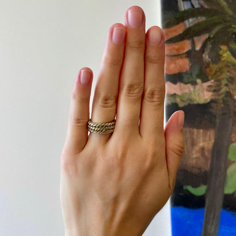 Vintage 1960's Tiffany & Co. 18 Karat Gold Woven Band. Signed Tiffany, with purity marks. Circa 1960's. Size 4 1/4.  About The Piece: If you like solid gold pieces, this ring is for you! Bold and gold rings are a really popular trend right now. An