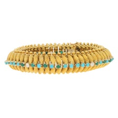 Vintage 1960s Turquoise and Diamond Bracelet in 18 Carat Yellow Gold 0.30 Carat