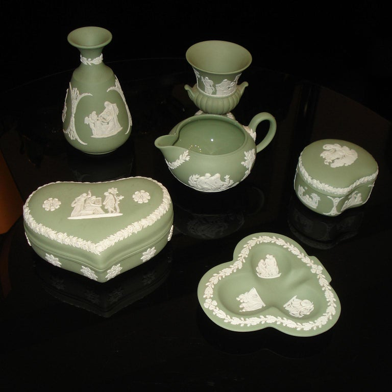 Midcentury small collection of six pieces Wedgwood Jasperware diamond cream on celadon. Comprising 2 vases, 2 lidded boxes, a pot and an ashtray. Vintage, 1960s. All in perfect condition. All marked under the bottom.