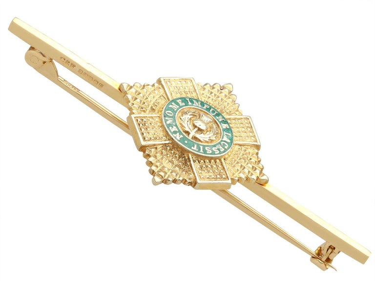 A fine and impressive vintage Scots Guard Brooch in 9 karat yellow gold and enamel; part of our diverse collection of military related items.  This impressive vintage Scots Guards regimental brooch has been crafted in 9k yellow gold.  The bar brooch