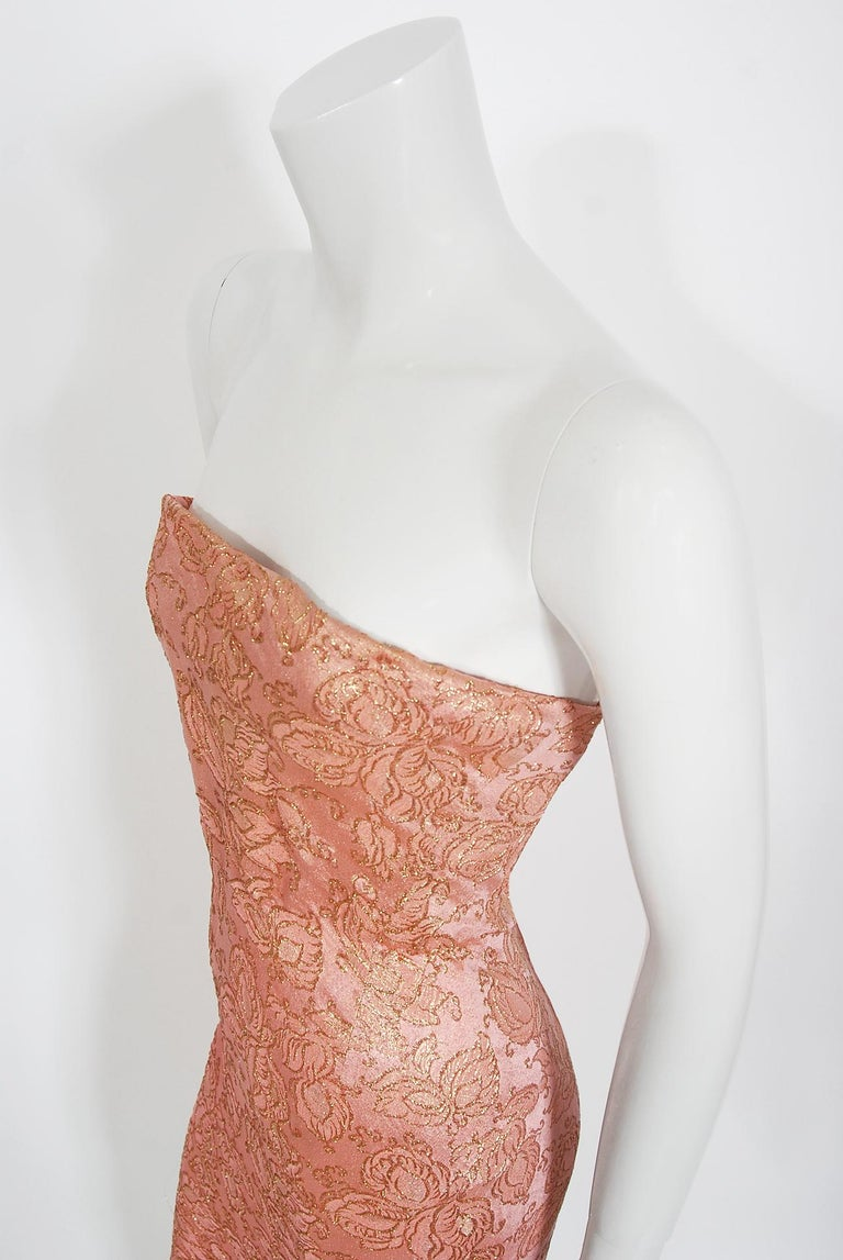 A stunning and incredibly rare Balenciaga metallic-gold brocaded pink silk evening dress from his 1964 Spring-Summer collection. Cristobal Balenciaga began his life's work in fashion at a very young age. It is fabled that the Marquesa de Casa