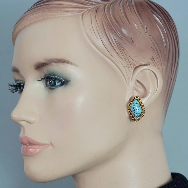 Vintage 1964 CHRISTIAN DIOR Turquoise Cabochon Braided Gilt Earrings  Measurements: Height: 1.02 inches (2.6 cm) Width: 0.67 inch (1.7 cm) Weight per Earring: 8 grams  Features: - 100% Authentic CHRISTIAN DIOR. - Braided gilt with turquoise stone